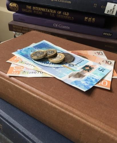 Money on top of books