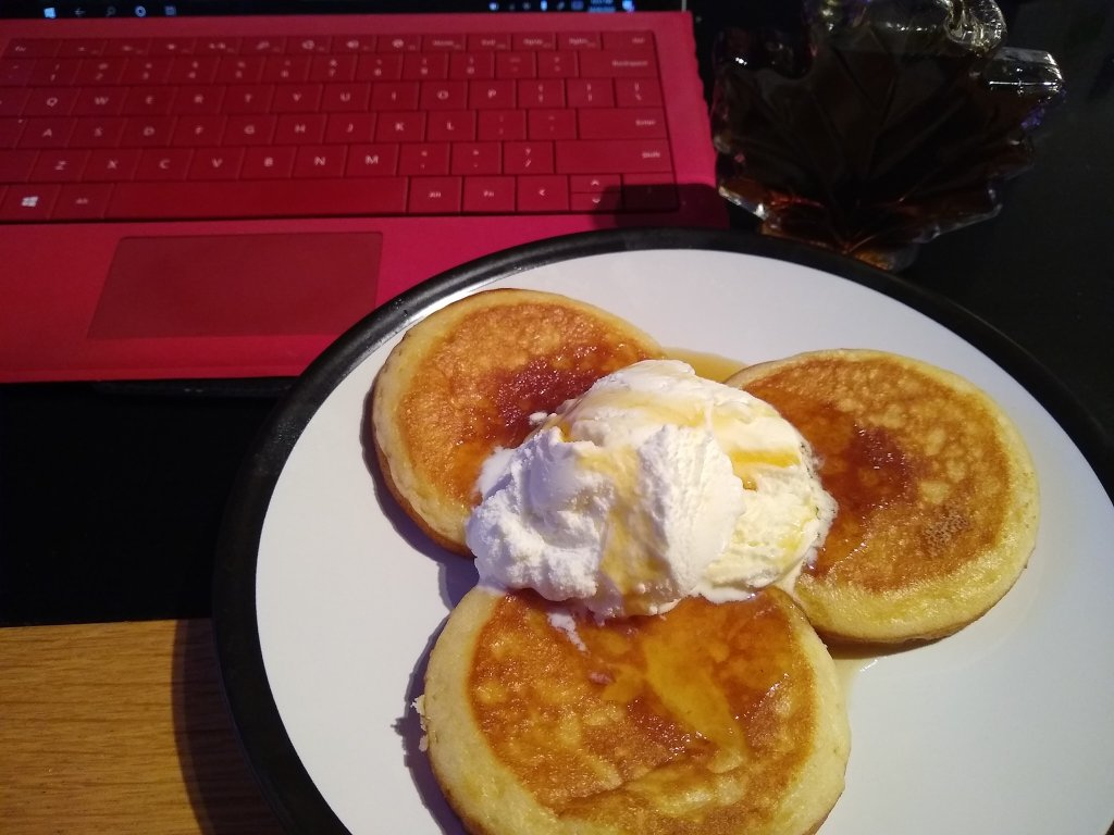 Pancakes and ice cream with syrup.