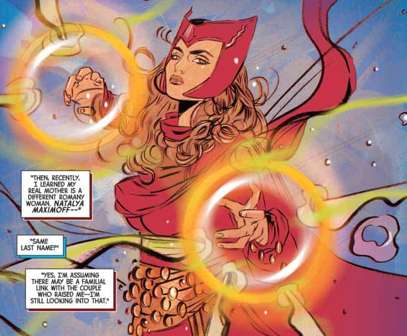 A picture of a panel from Scarlet Witch #8. Wanda Maximoff is dressed in her Scarlet Witch outfit (all red, with a pointed headpiece) and is poised as if to start using her magic. Gold and white circles frame her hands and in the bottom left, speech boxes state: 'Then, recently, I learned my real mother is a different Romany woman. Natalya Maximoff--'; 'Same last name?'; 'Yes, I'm assuming there may be a familial link with the couple who raised me -- I'm still looking into that.'
